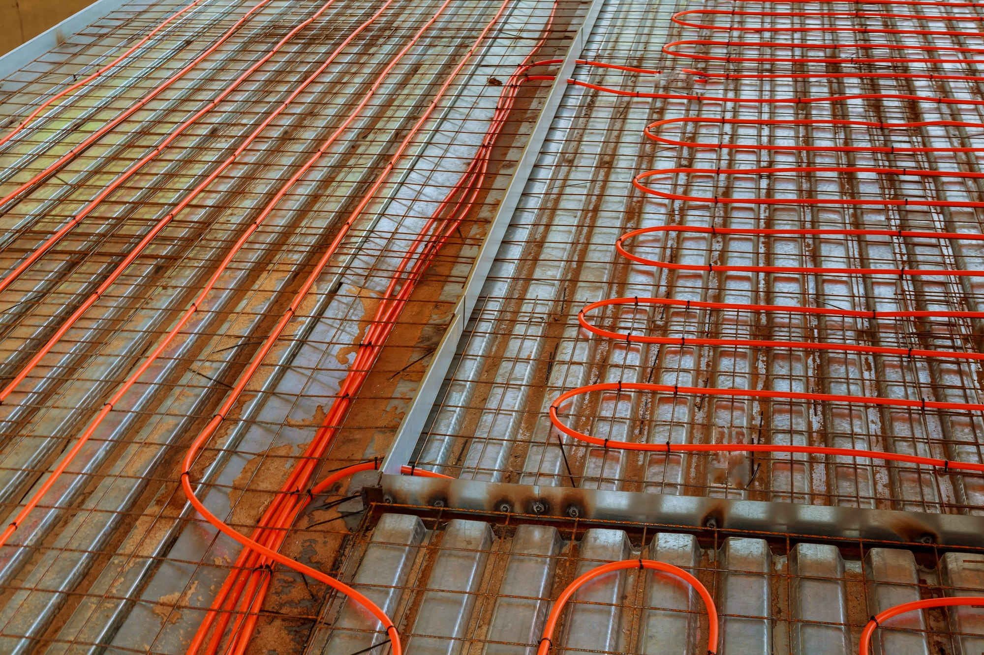 New floor heating system Pipes and heating system at house construction site
