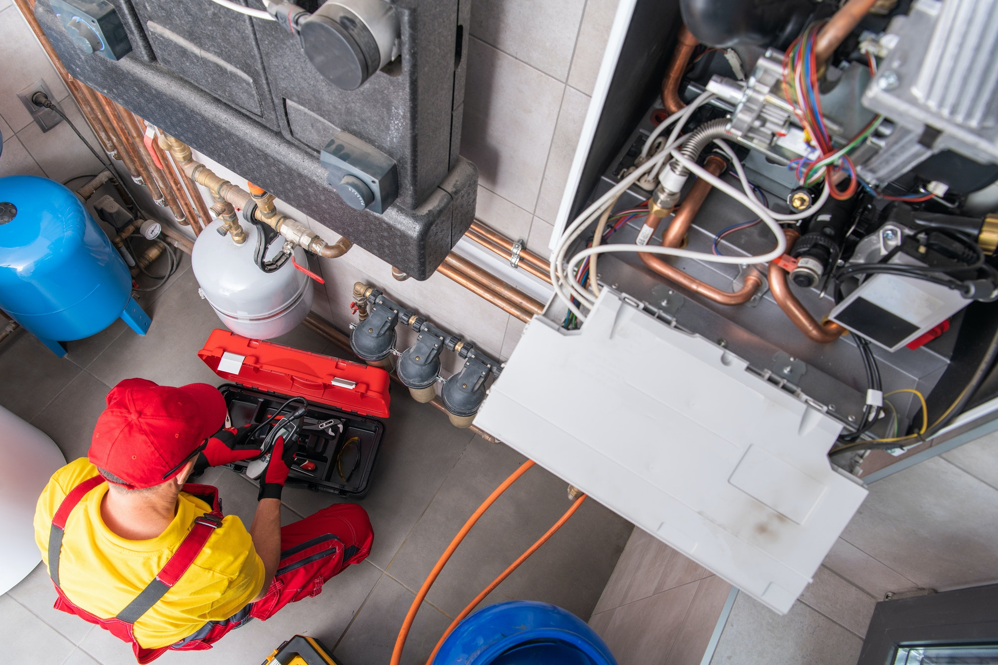 Residential Heating Systems Technician Performing Maintenance